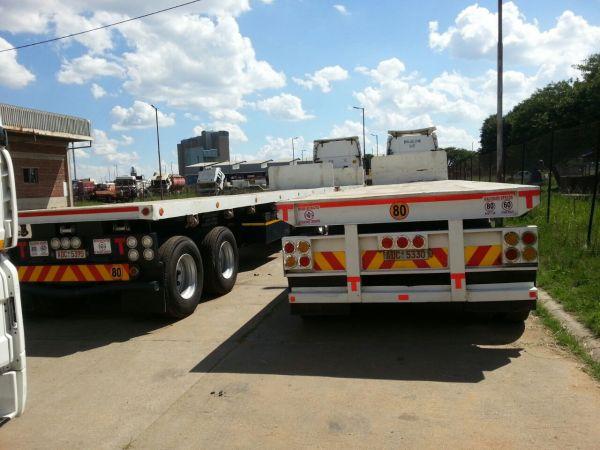 Tri-axle flat deck trailer for sale